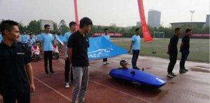 学生自制节能电动车 不仅节能还可以舒服躺着开